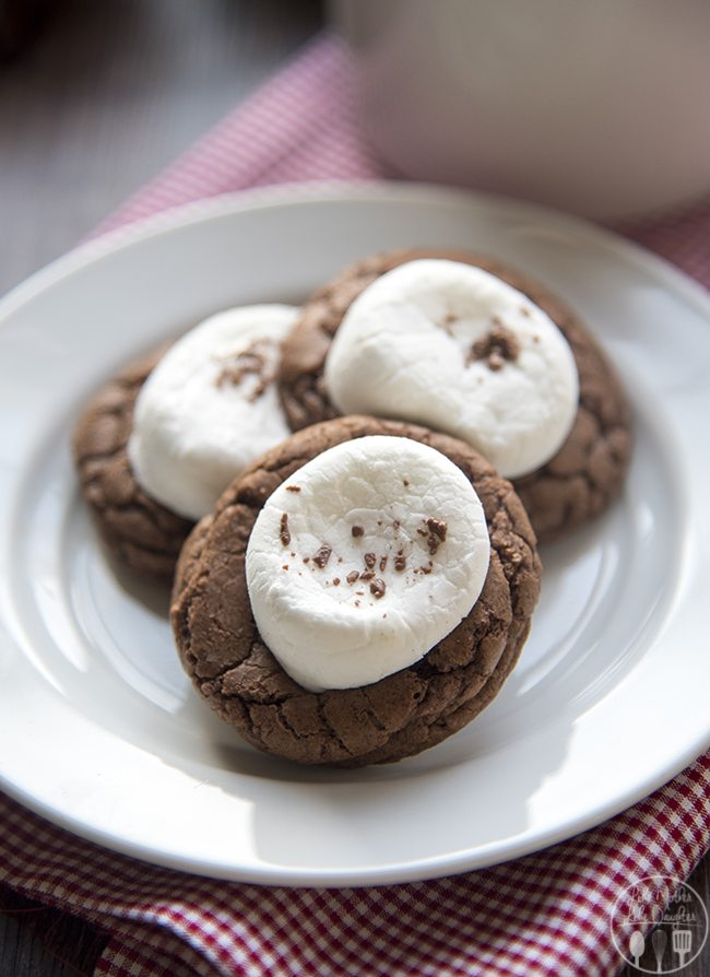Hot chocolate cookies are like hot cocoa in cookie form, with a soft, rich, chocolate cookie topped with melted chocolate and a gooey marshmallow! Just like your favorite cup of cocoa!