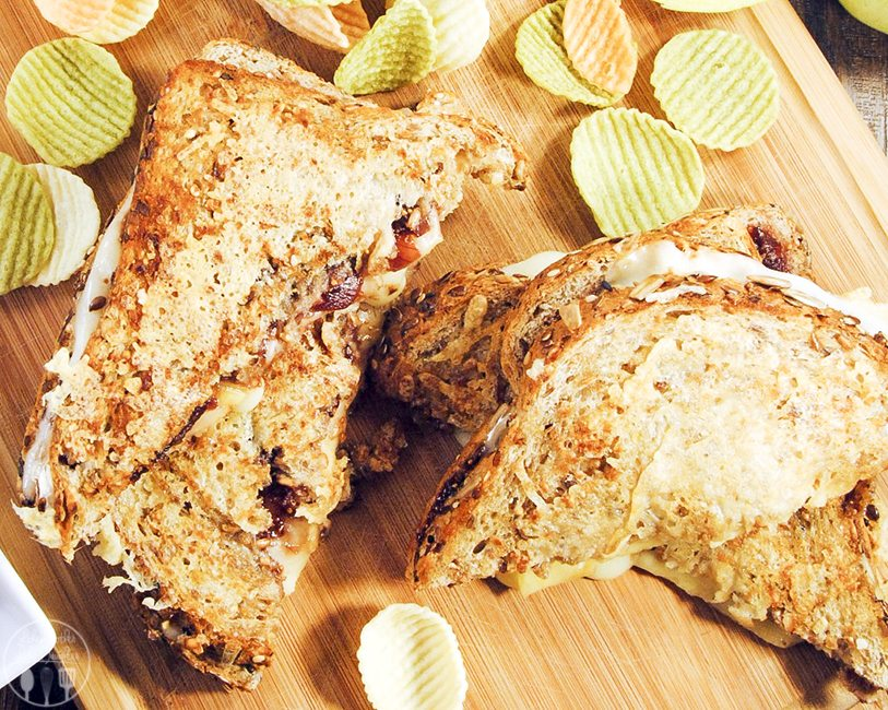 This three cheese panini with apples and fig jam is a delicious twist on the traditional grilled cheese sandwich. With harvati, brie and parmesan cheese, fig jam and green apple slices.
