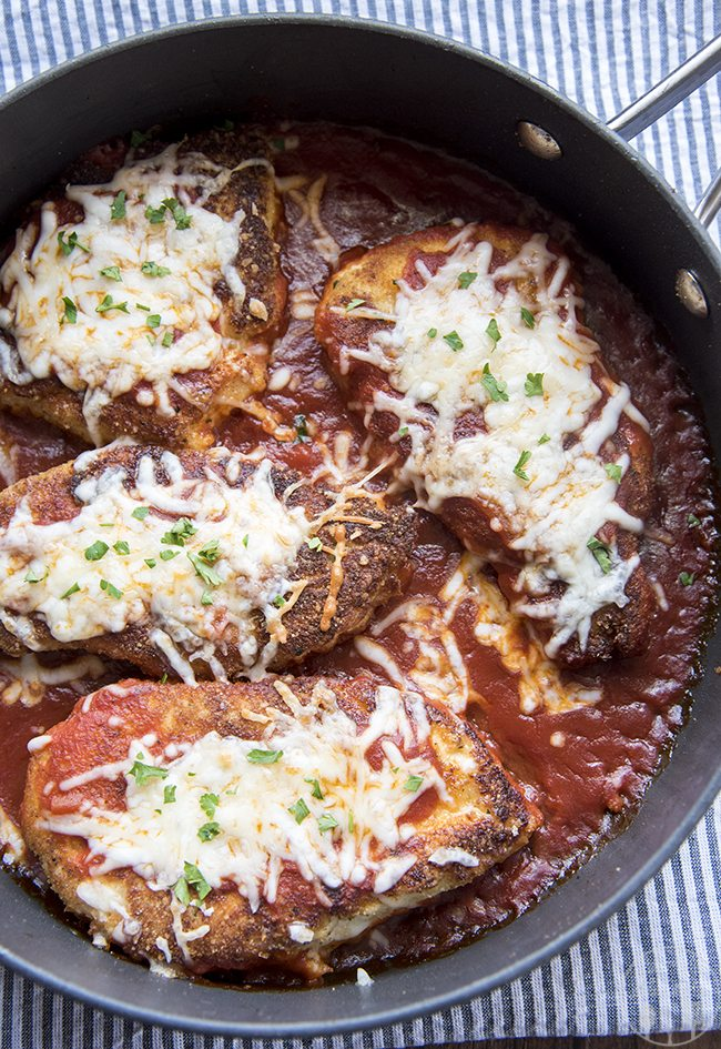 Chicken Parmesan - Crispy bread crumb coated chicken in marinara sauce topped with melted cheese. Serve this dish with pasta for a delicious Italian style meal!