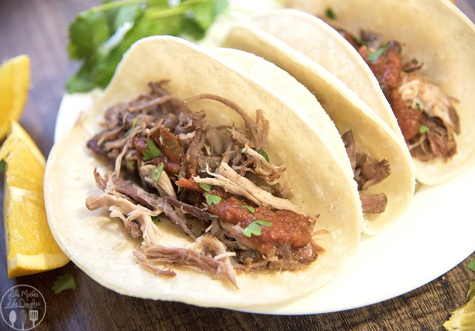 Slow Cooker Pork Carnitas - These deliciouslyflavored pork carnitas are cooked to perfection in the slow cooker for several hours. Then cooked on the skillet to get that perfect crunch while keeping the meat juicy! Great plain or eaten on tacos!