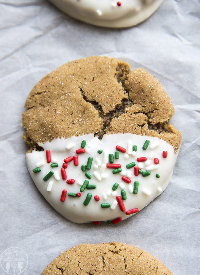 White Chocolate Dipped Ginger Cookies - These white chocolate dipped ginger cookies are a perfect Christmas cookie! They're soft ginger and molasses cookies with white chocolate and Christmas sprinkles!