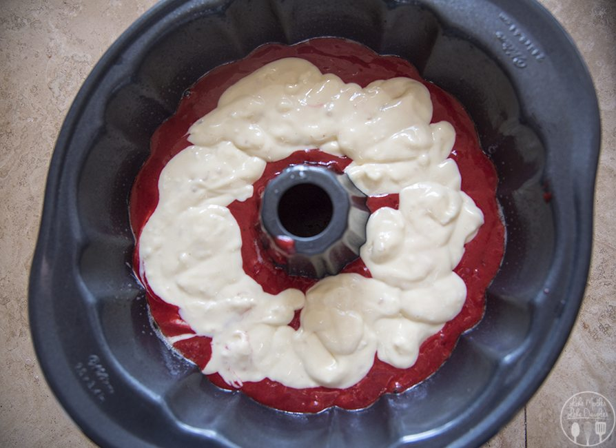 Cream Cheese Swirled Red Velvet Bundt Cake - This delicious red velvet bundt cake is a delicious moist cake, full of a cheesecake like filling and topped with a homemade white chocolate ganache. This cake is perfect for any occasion and especially for the holidays!