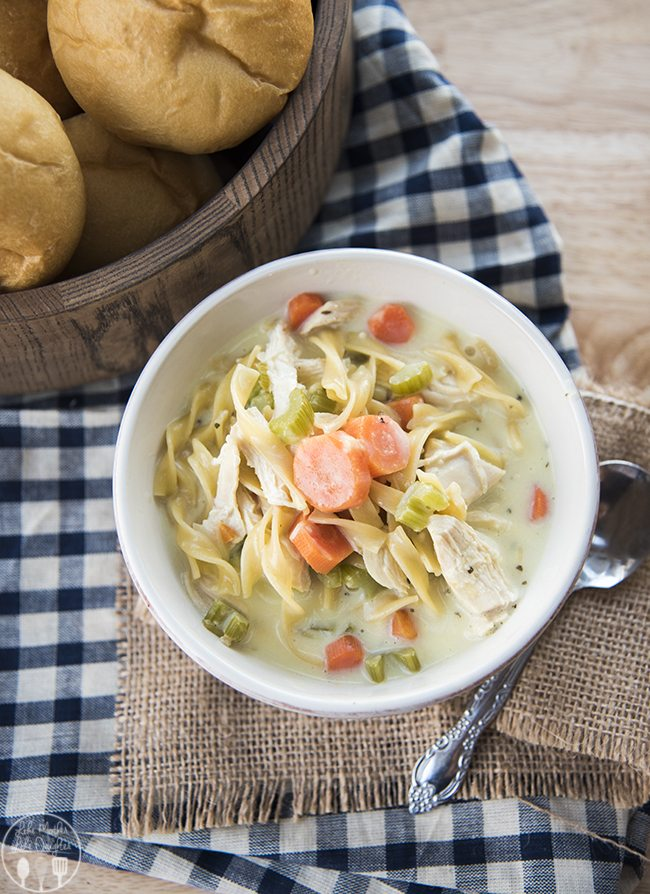 Creamy Chicken Noodle Soup - This creamy chicken noodle soup is packed full of shredded chicken, carrots, celery, onion and egg noodles, with a creamy broth. Its perfectly hearty and comforting!