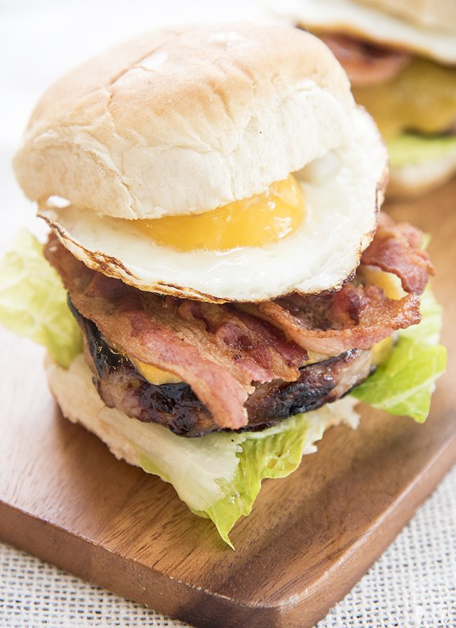 Bacon and Egg Burger - This burger is a perfect burger with a breakfast twist. It starts with a premium pork patty, topped with cheese, crispy bacon and a fried egg!
