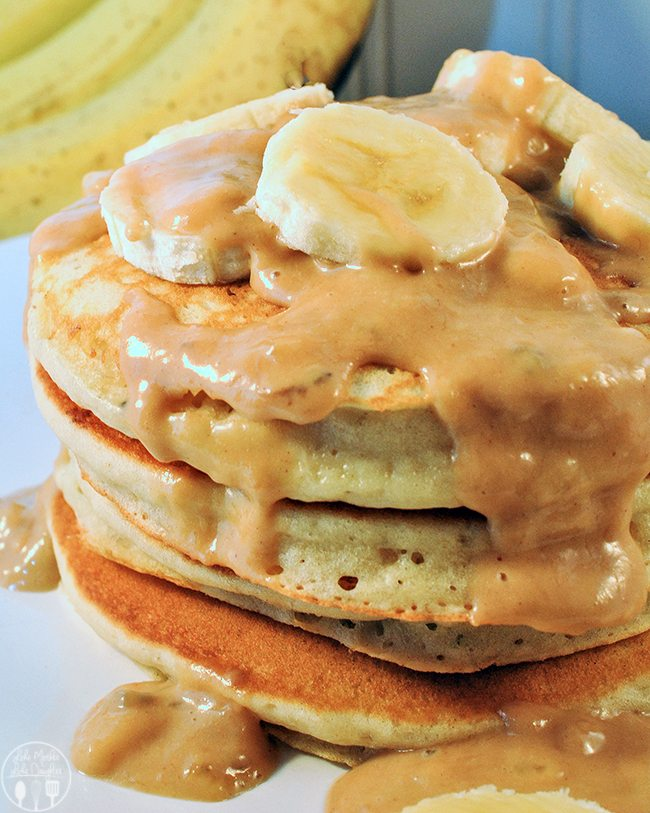 Chunky Monkey Pancakes - These pancakes perfect pancake flavored throughout with bananas and chocolate chips and topped with a banana peanut butter sauce.
