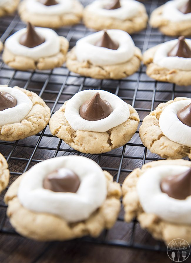Hershey Kiss S'mores Cookies - These s'mores cookies start with a graham cracker filled cookie base, topped with a gooey marshmallow, and a chocolate kiss - for your favorite s'mores flavors in adelicious and cute cookie