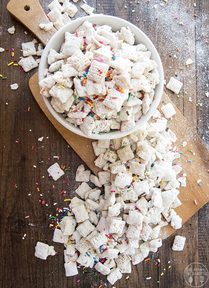 Cake Batter Muddy Buddies - These muddy buddies are an addicting snack that tastes just like cake batter!