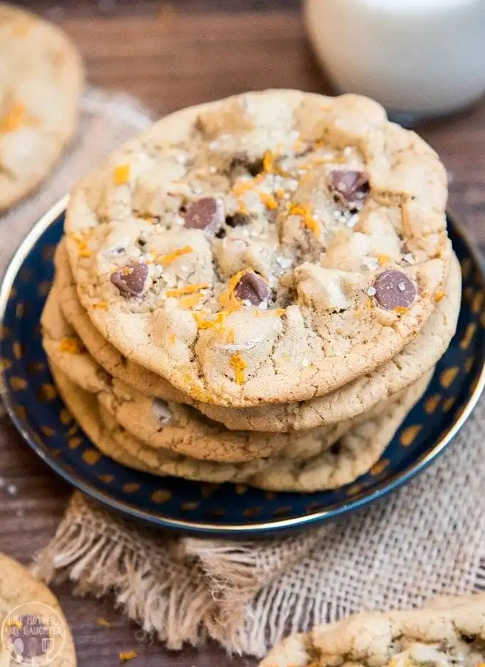 These orange chocolate chip cookies, are amazing chewy chocolate chip cookies topped with just a little orange zest at the end for the perfect citrus flavor burst.