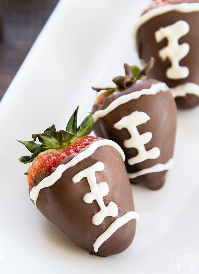 Football Chocolate Covered Strawberries are not only easy to make, they're also delicious to eat and so cute for a football watching party!
