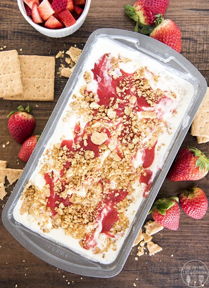 Strawberry cheesecake ice cream with a creamy cheesecake ice cream base, and a sweet strawberry sauce and buttery graham cracker crust swirled throughout.
