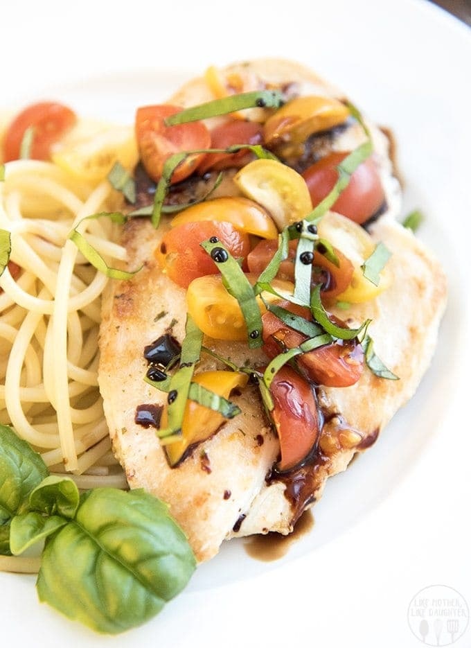 This bruschetta chicken combines the perfect flavors of tomato bruschetta on top! Its garlic seasoned chicken breast, topped with chopped tomatoes, basil and balsamic vinegar for an amazing lighter meal you'll love!