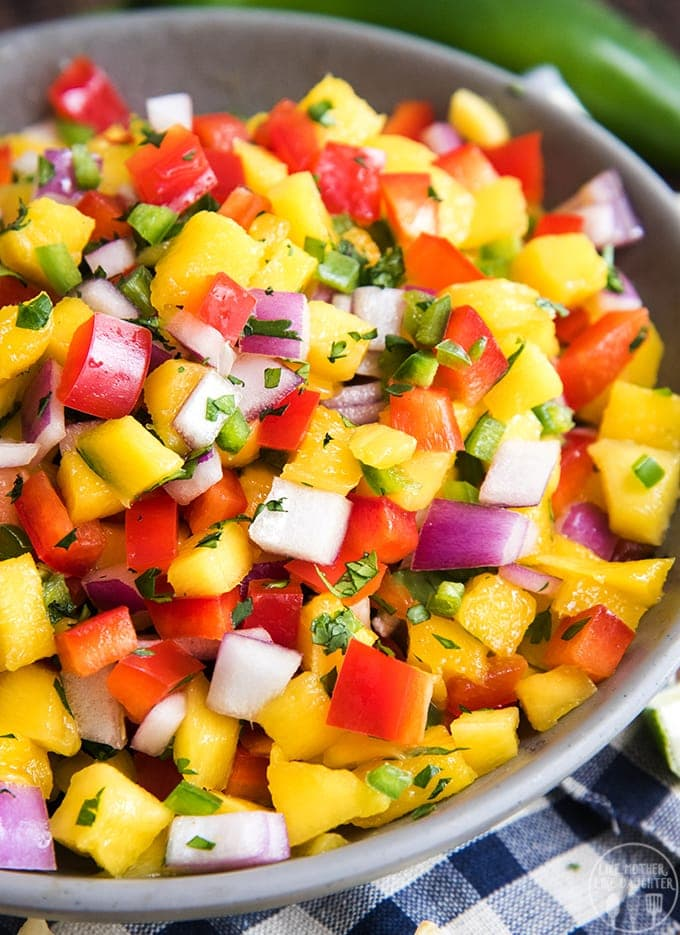 Fresh mango salsa is easy to make, and its so delicious served with chips, on grilled meat, tacos, and more!