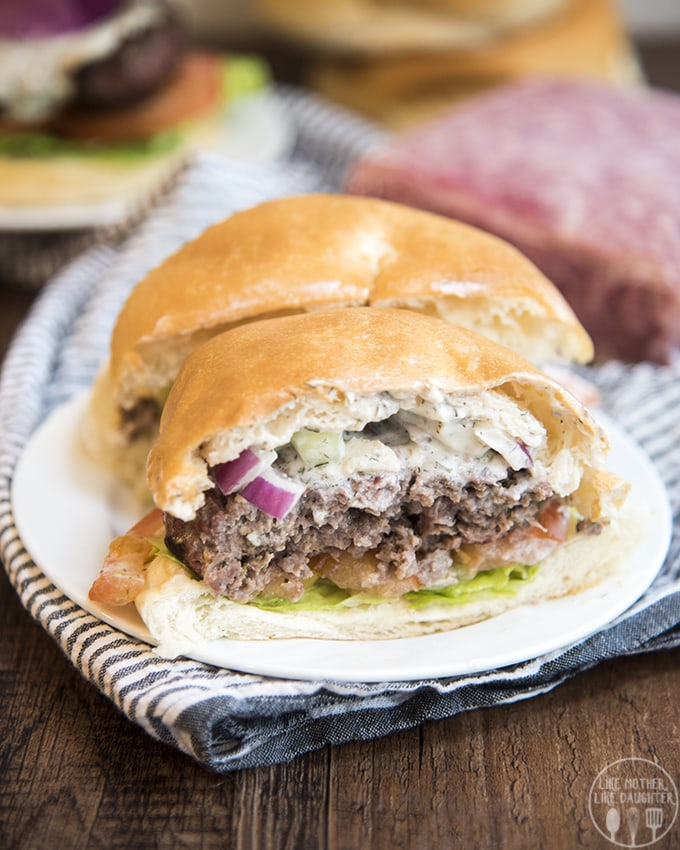 This Greek gyro lamb burger recipe has the same great flavors of a gyro in burger form. With a perfectly seasoned grilled lamb burger topped with homemade tzatziki sauce.