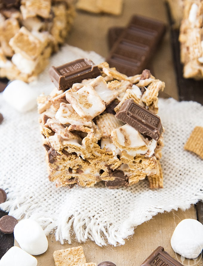 S'mores krispy treats are a twist on traditional rice krispy treats, these are made with golden graham cereal and chocolate in addition to the gooey marshmallows.