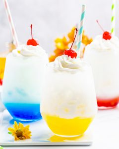 Cups of yellow, blue, and red Italian sodas.