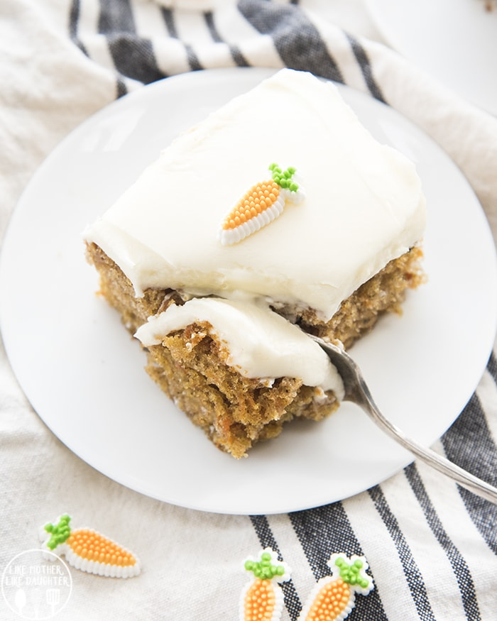 This easy carrot cake is made in a 9x13 pan and topped with the best cream cheese frosting! Perfect for an Easter dessert!