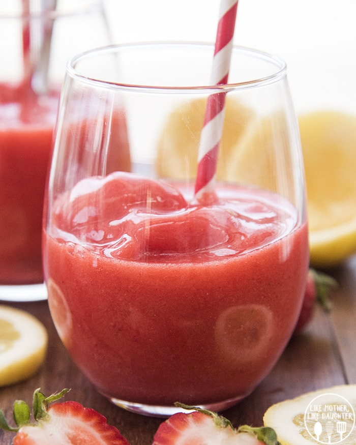 This Strawberry Lemonade Slush is only 3 ingredients, and the perfect sweet drink to stay cool with in the summer!