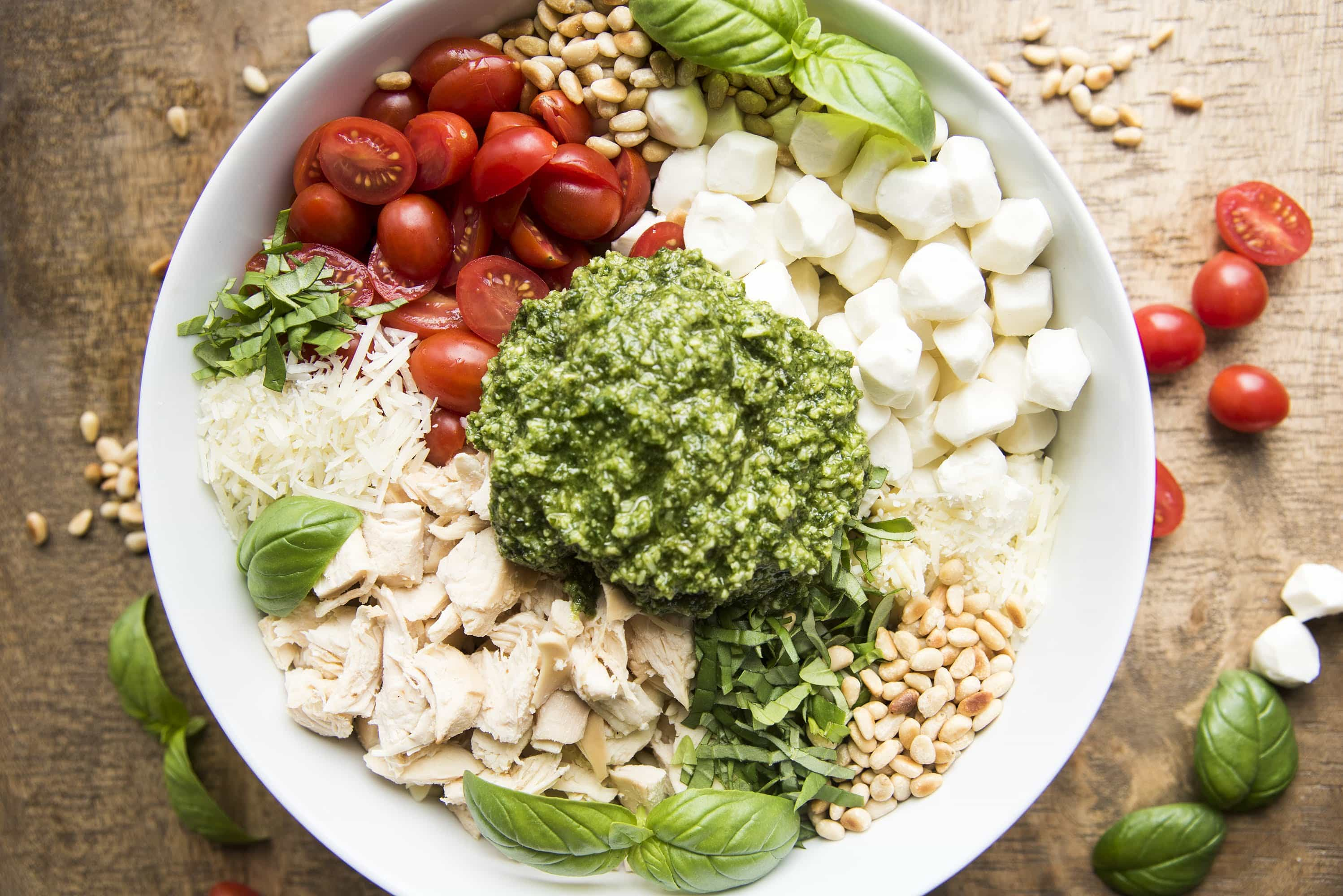 This pesto pasta salad can be easy to make with store bought pesto, rotisserie chicken, and mozzarella pearls!