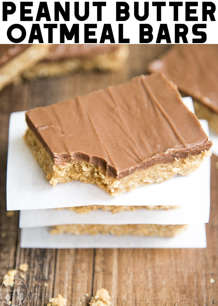 These peanut butter oatmeal bars are rich and hearty peanut butter cookie bars packed full of oatmeal, and topped with more creamy peanut butter and a rich chocolate frosting - perfect for a crowd!