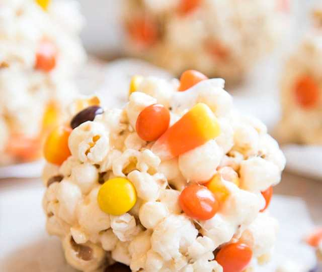 Halloween Popcorn Balls Are Delicious Gooey Marshmallow Popcorn Balls Stuffed Full Of Your Favorite Halloween Candies