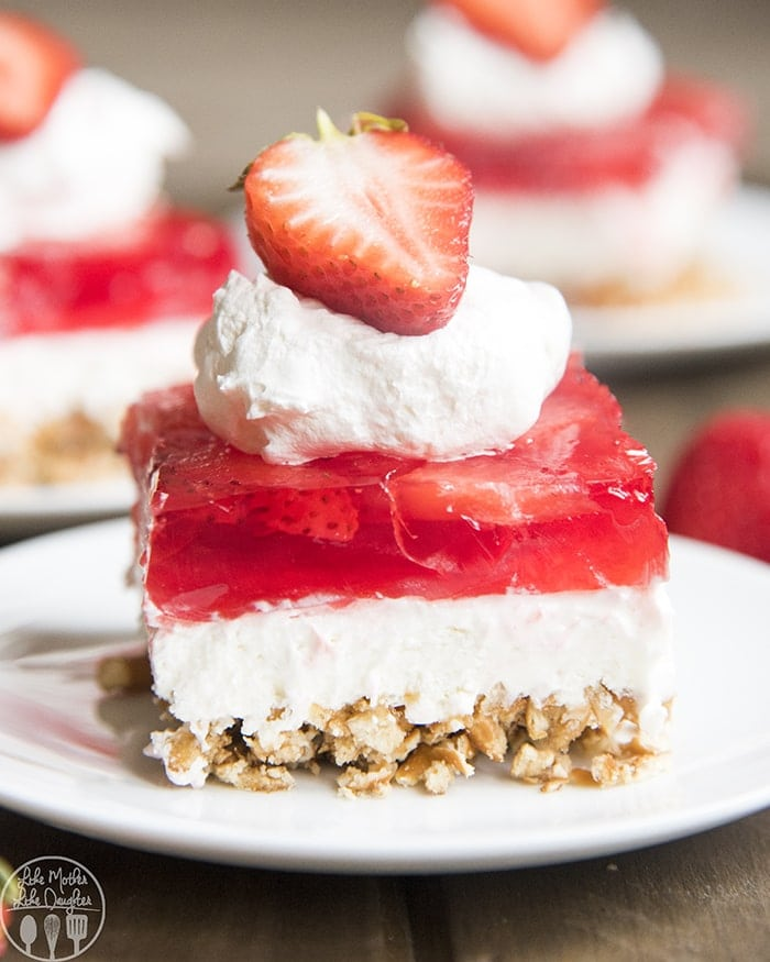 Strawberry Pretzel Jello Salad is the perfect side dish or dessert. It's the perfect sweet and salty food, with a crunchy pretzel crust, sweet cream cheese middle, and a strawberry jello topping.