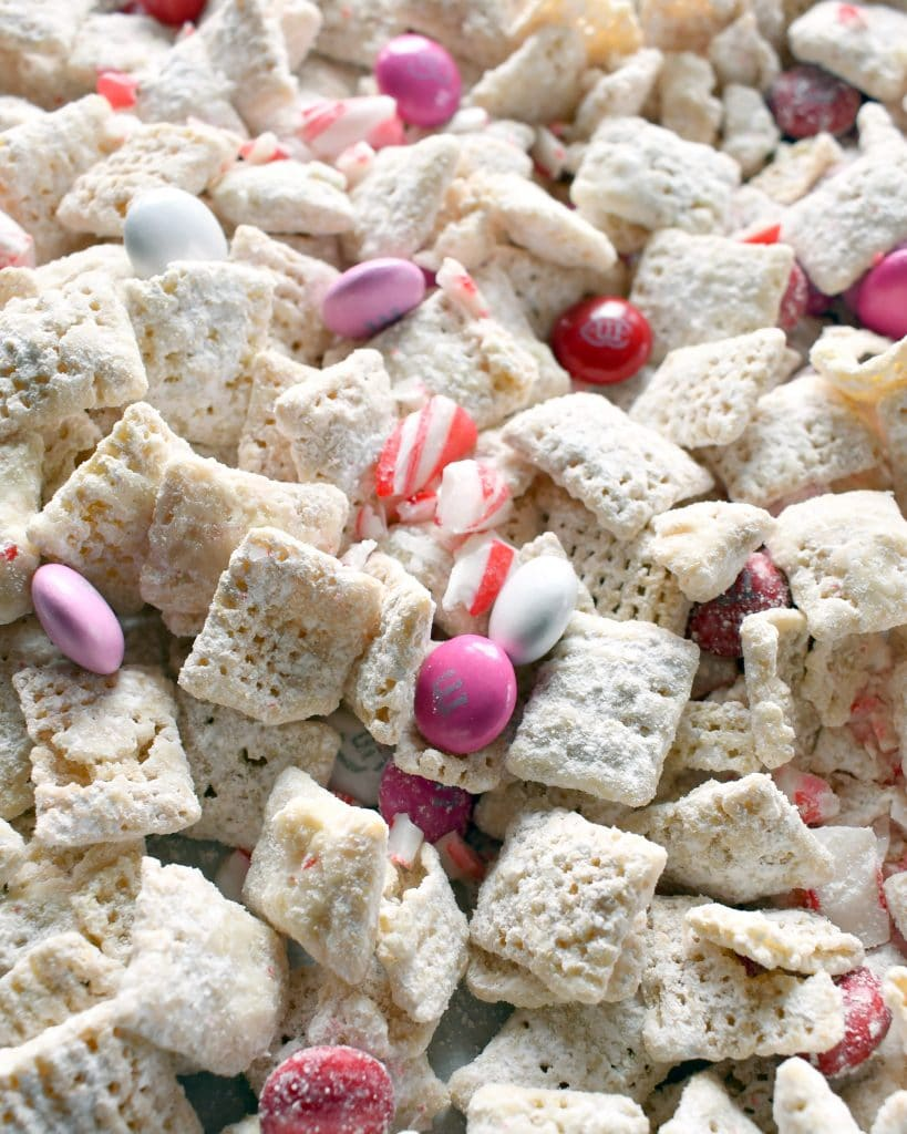 This peppermint candy crush puppy chow will be favorite puppy chow with peppermint candy cane flavor; crushed candy cane, pink, red, and white M&Ms.