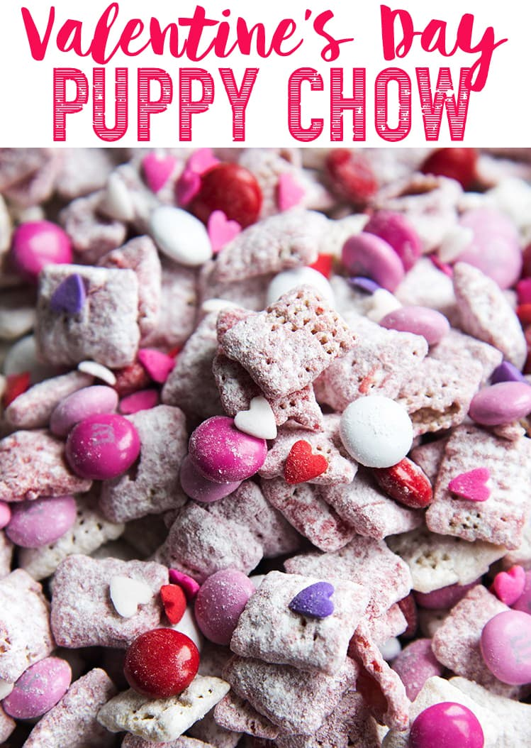 This Valentine Puppy Chow is the perfect Valentine's Day treat with red and white Strawberry muddy buddies scattered with red, pink, and white m&ms, and sprinkles.