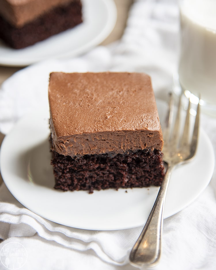 This easy chocolate cake is the best chocolate cake ever, it's fudgy, moist, and so delicious. It's topped with a creamy and rich chocolate buttercream and is the perfect cake for chocolate lovers!