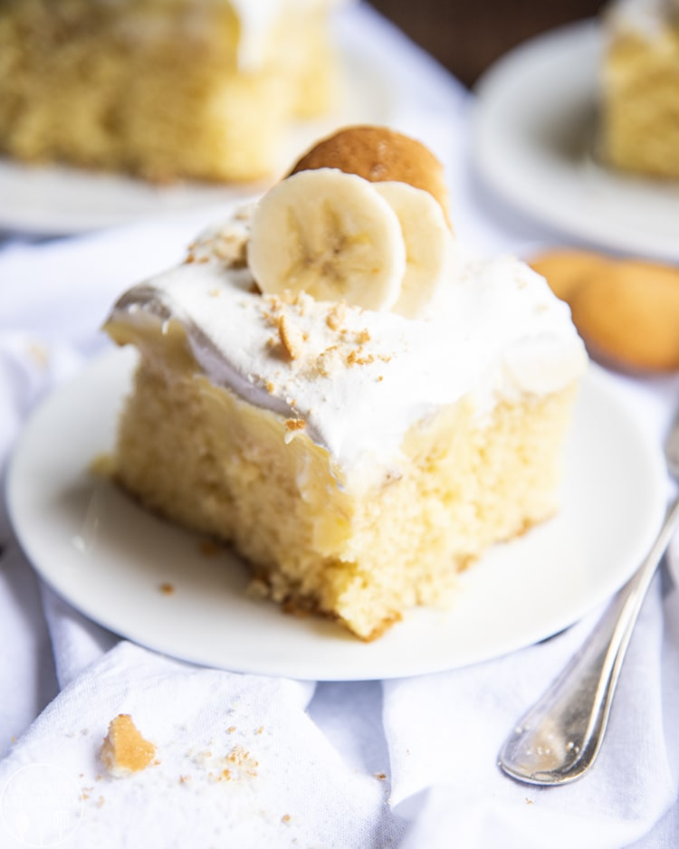This banana pudding poke cake has all the great flavors of banana cream pie, but in the form of a cake! With a yellow cake topped and filled with banana pudding, covered in banana slices, whipped cream, and crushed cookies, this poke cake is the best!