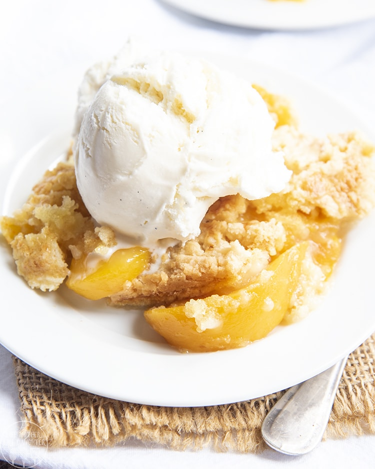 This peach cobbler dump cake is the perfect easy dessert, only three ingredients. It's got the perfect sweet peaches in every bite, topped with a crunchy sweet cake topping. Top it with vanilla ice cream for the perfect warm dessert!