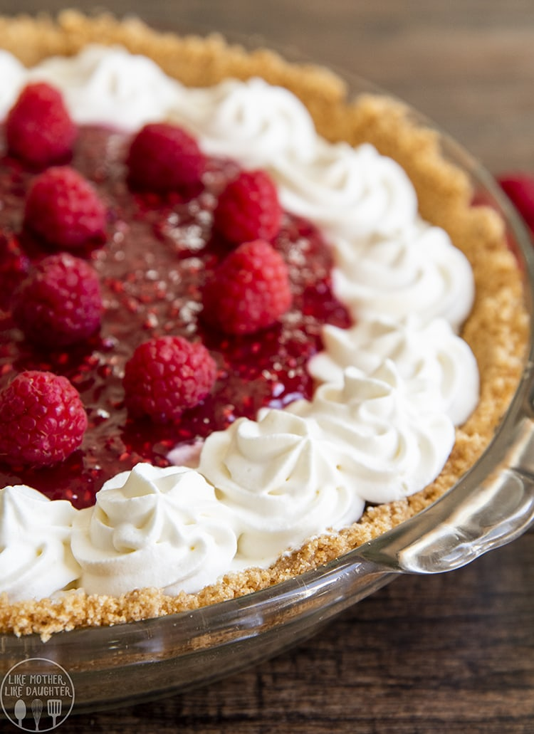 Raspberry Cream Cheese Pie topped with raspberries and whipped cream