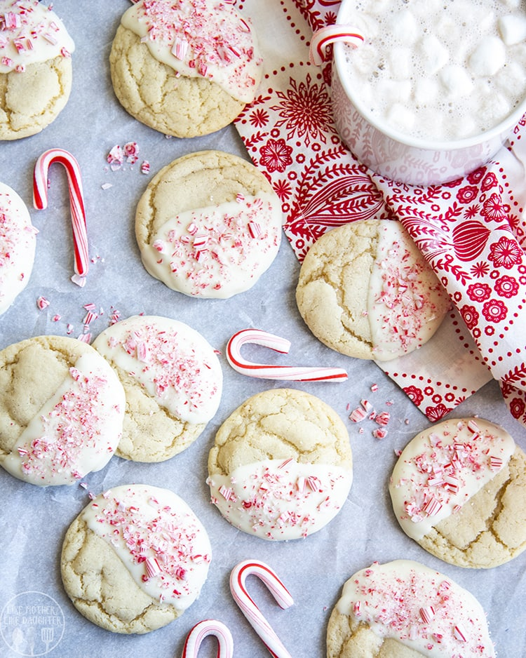 Sugar cookies dipped in white chocolate and peppermint candies