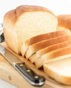 A loaf of white bread cut into slices