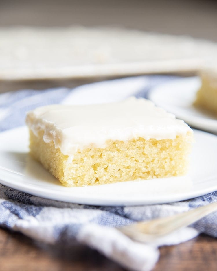 A slice of white texas sheet cake on a plate