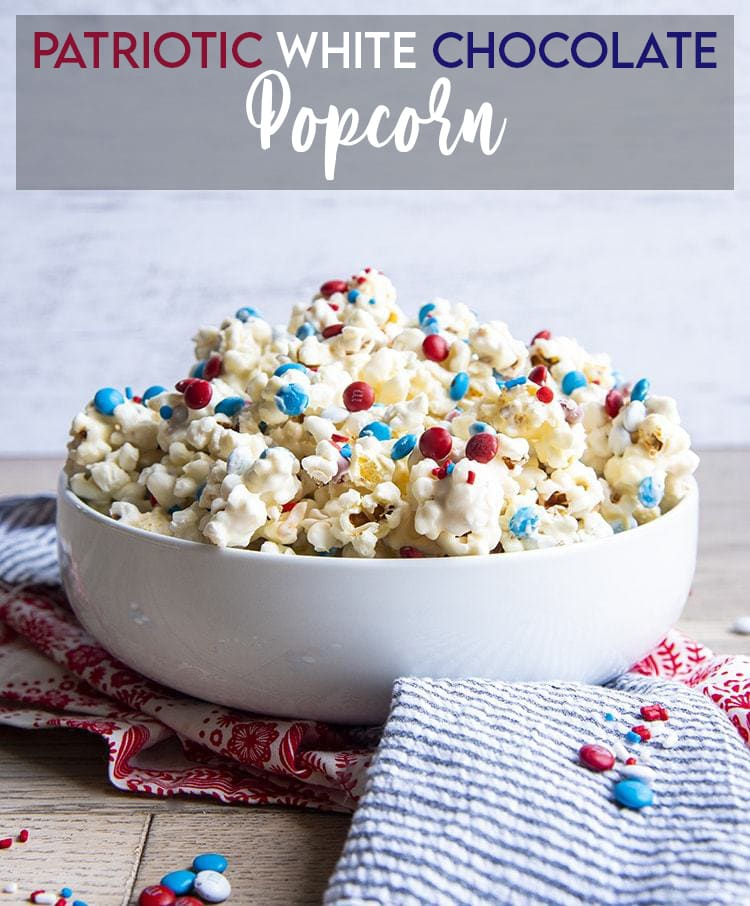 White Chocolate Popcorn with red and blue m&ms with text overlay for pinterest