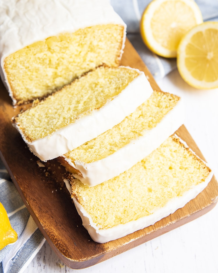 Slices of lemon loaf on a cutting board