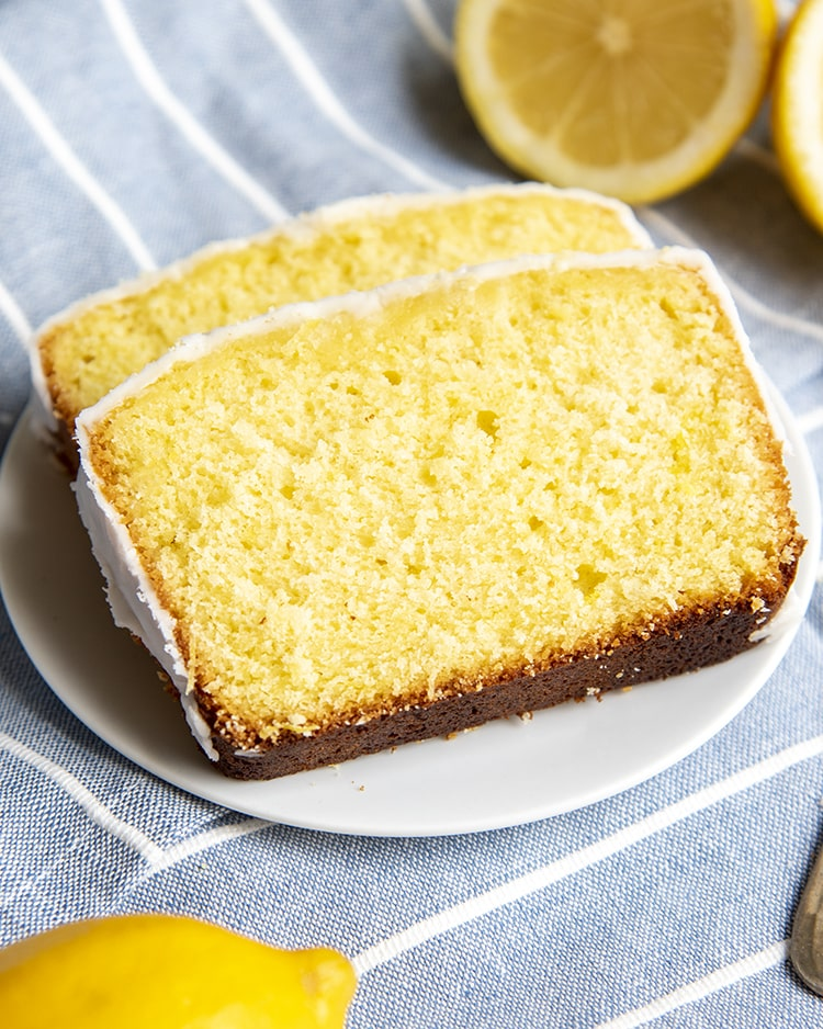 Two pieces of lemon sweet bread on a plate.