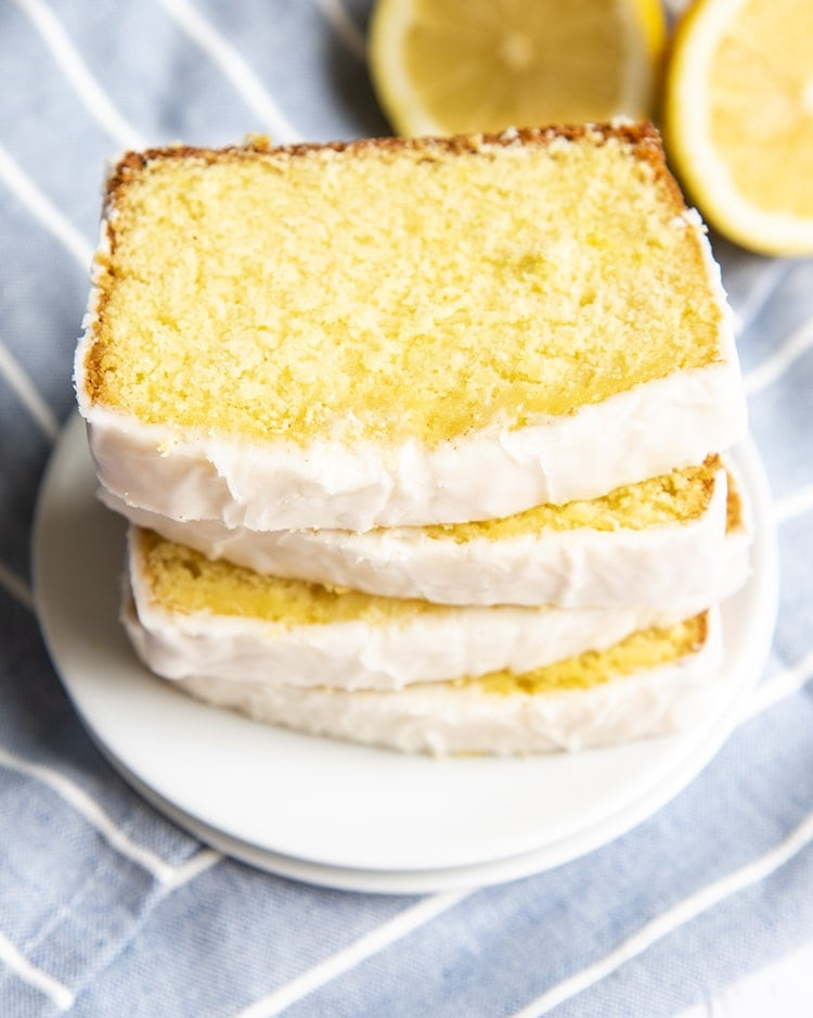 A stack of lemon pound cake slices on top of each other.