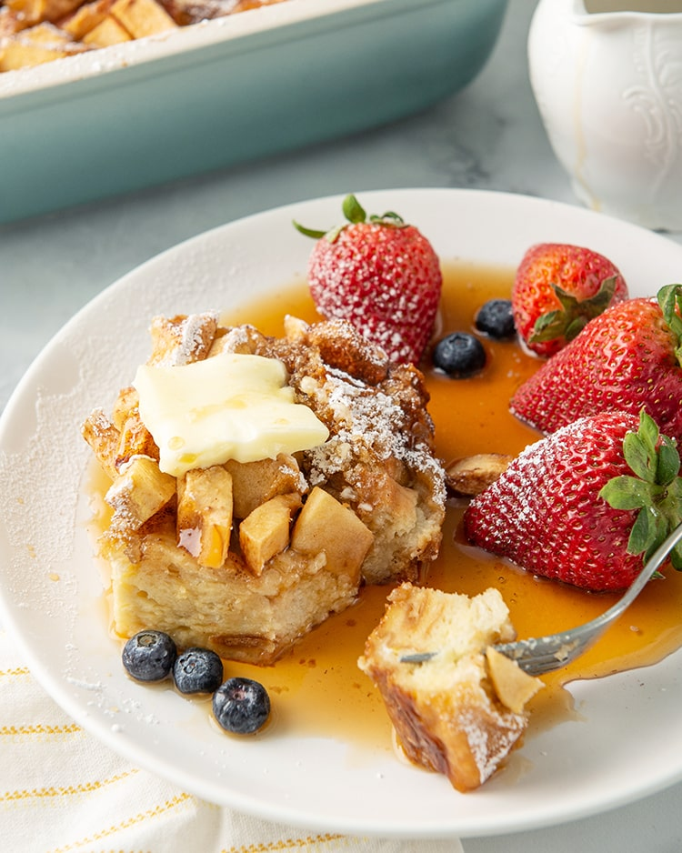 Overnight apple french toast casserole on a plate with syrup