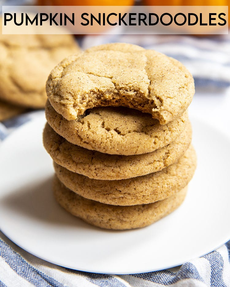 A stack of pumpkin snickerdoodle cookies. The top cookie has a bite taken out of it with text overlay for pinterest.
