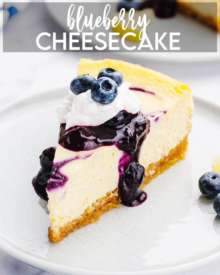 A slice of blueberry cheesecake topped with a blueberry sauce, and a dollop of whipped cream, and fresh berries. With a text overlay for pinterest that says Blueberry Cheesecake.