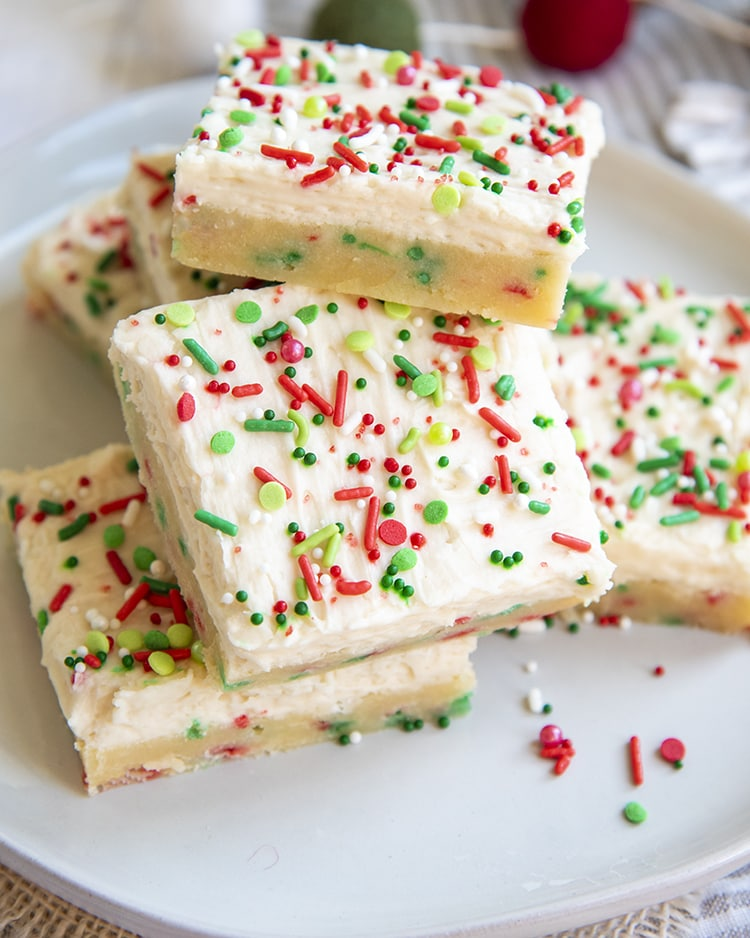 A stack of Christmas Sugar Cookie Bars on a white plate.