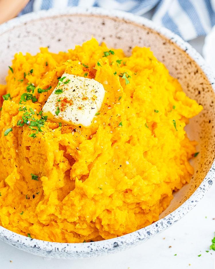 A shot of a bowl of savory mashed sweet potatoes.