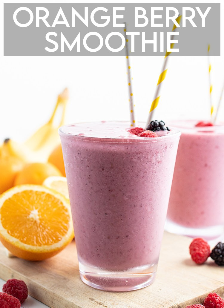 """A side shot of a glass filled to the brim with a purple-ish berry smoothie. It has two paper straws in the glass, there is a text overlay at the top that says """"Orange Berry Smoothie""""."""