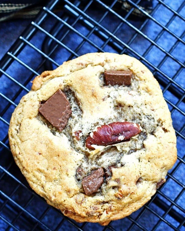 One banana chocolate chunk cookie on cooling rack.