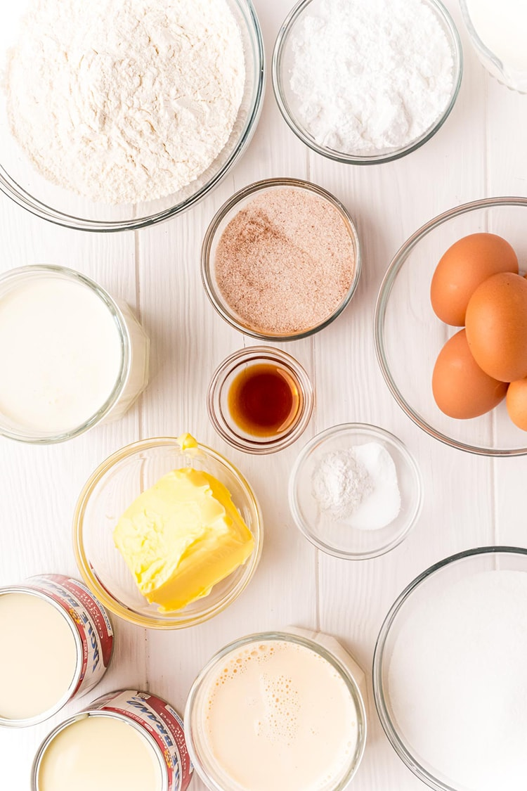 The ingredients to make tres leches cake, all separated into bowls.