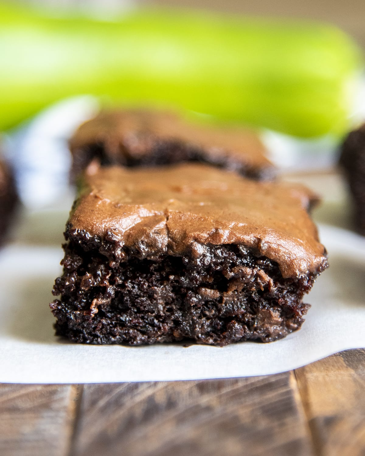A chocolate zucchini brownie topped with chocolate icing.
