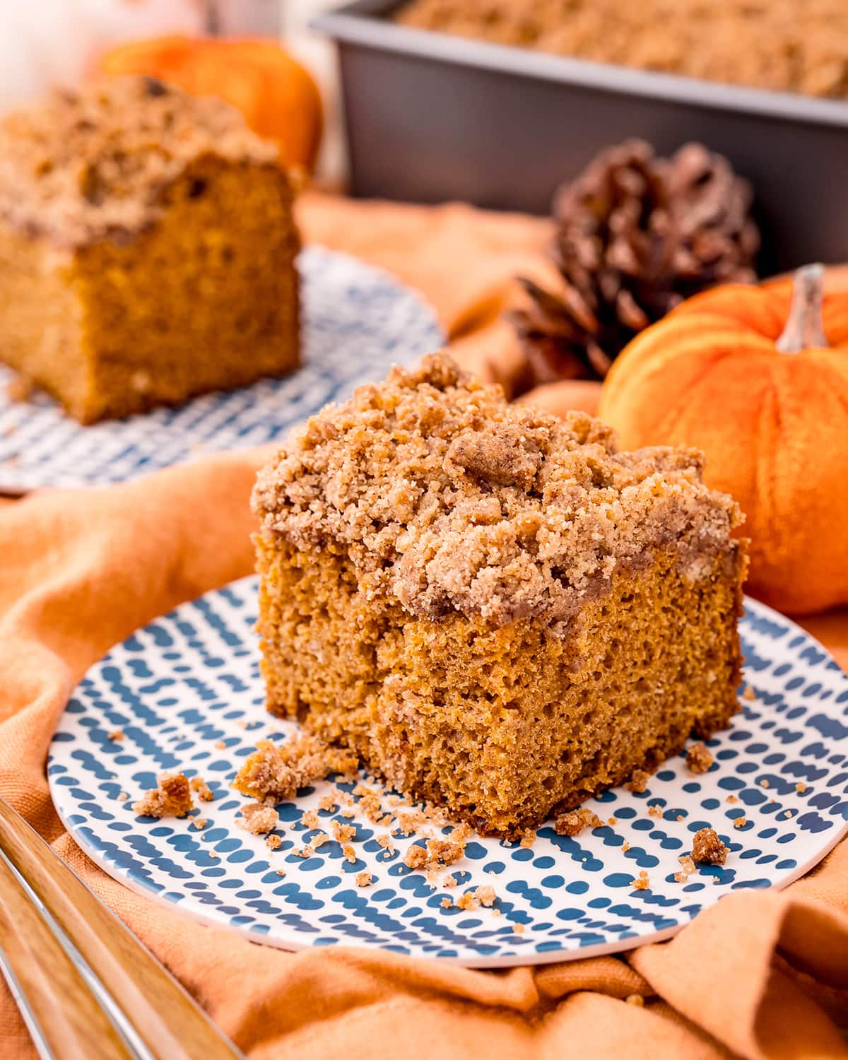A piece of pumpkin coffee cake with a sugar crumble topping.