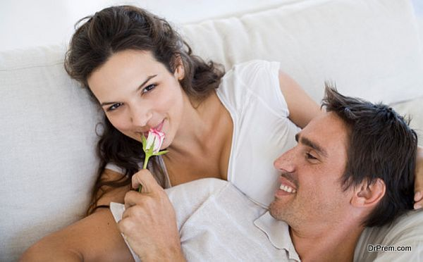 Couple relaxing together with flower