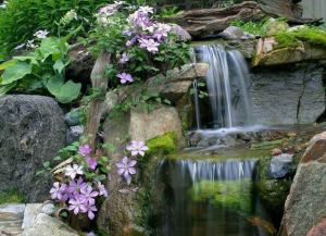 15 Relaxing Backyard Waterfalls Ideas For Your Outdoor 12
